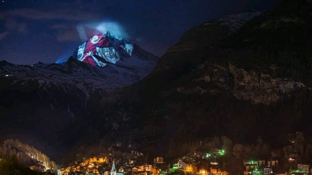 Nepal's flag illuminated on Switzerland's Matterhorn Mountain